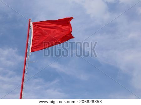 Red Waving Flag Indicating A State Of Danger