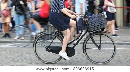 Woman While Fast Pedal On Bicycle And The Background Intentional