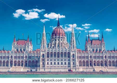 Closeup of Parliament building of Budapest above Danube river in Hungary neo-gothic style architecture