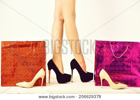 Sexy Female Legs In Shoes With Shopping Bags, Packages