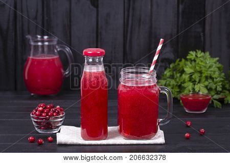 Cranberry Juice And Raw Cranberry On Black Wooden Background, Close Up