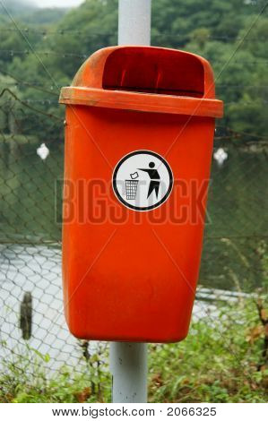 Orange Recycle Bin Fixed On A Metal Support