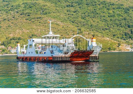 KOTOR, MONTENEGRO -  AUGUST 24, 2017: Ferry in the Kotor bay, Montenegro.