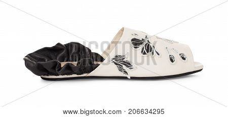 Beautiful female leather slipper with frills on heel and decor on a white background