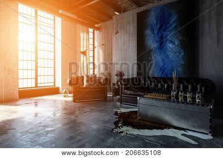 Warm sunset light streams through tall windows illuminating a contemporary, industrial polished concrete living room interior with leather lounges and modern art hanging. 3d Rendering
