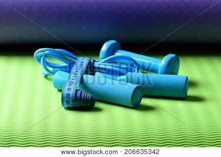 Skipping Rope, Dumbbells In Cyan Color Tied With Measuring Tape