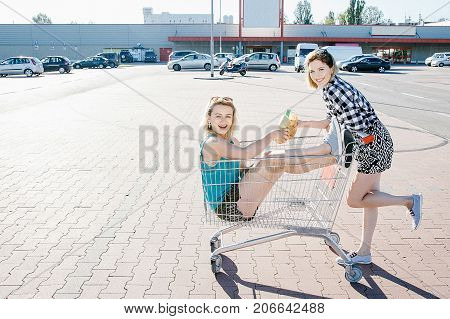 Girls Drink Alcohol At The Supermarket.