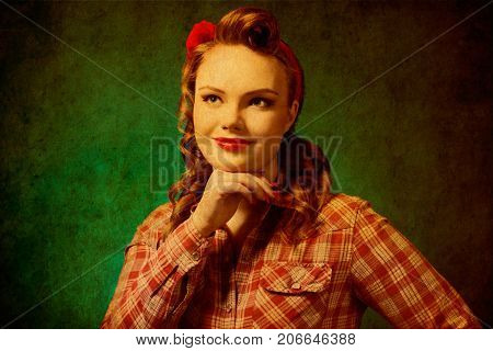 Closeup young pretty pinup girl red button shirt looking up teal color background retro vintage 50's style. Human emotions body language