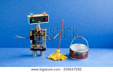 Robot cleaner with yellow mop, bucket of water, sweeping floor. Cleaning washing room service concept. Creative design toy cyborg in blue apartment