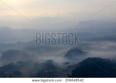 aerial view silhouette mountain range cover by fog at dawn in Thailand with copy space