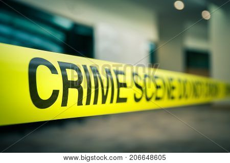 crime scene tape focus on word 'crime' in cenematic dark tone with copy space