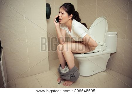 Beautiful Attractive Woman Sitting On Toilet
