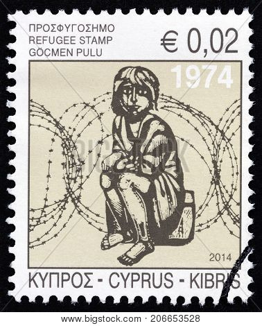 CYPRUS - CIRCA 2014: A stamp printed in Cyprus shows a child in front of barbed wire (wood engraving by A. Tassos), circa 2014.