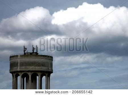 Rain clouds building up over a water tower
