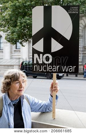 London 28th September 2017:- Protesters gather in Whitehall opposite Downing Street to protest the growing tensions between North Korea and the USA