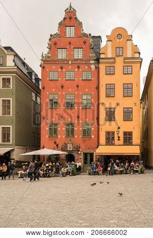 STOCKHOLM, SWEDEN - SEPTEMBER 9: Tourists in Stortorget square in Gamla Stan on September 9, 2017 in Stockholm, Sweden. The Nobel Museum is in this square.
