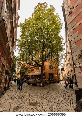 STOCKHOLM, SWEDEN - SEPTEMBER 9: Tourists in Tyska Brunnsplan square in Gamla Stan on September 9, 2017 in Stockholm, Sweden. The square was first mentioned in 1649