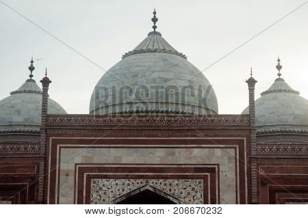 The domed roof and minarets of the Jama Masjid mosque situated in front of the famous Taj Mahal monument