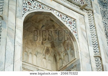 Arched marble doorway with beautiful designs and carving. These form an important part of the beauty of the Taj Mahal