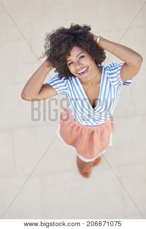 Happy Afro American Woman Holding Hands Above Head