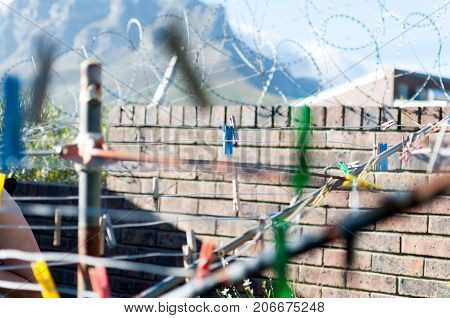 Barbwire wall for security at prison and clothesline clothes pins