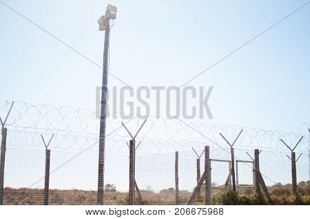 Prison barb wire fense criminal obstacle protect warning trespass