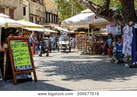 RHODES, GREECE - AUGUST 2017: Street of Rhodes town with many shops and bars. Rhodes island, Greece.