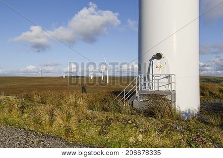Base of a Wind Turbine on a wind farm with the entry door for access.