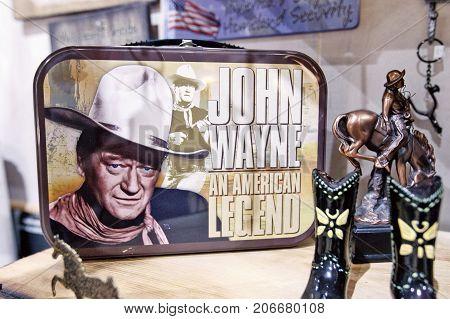New York September 25 2017: John Wayne themed merchandise is displayed on the shelves of a store in Manhattan.