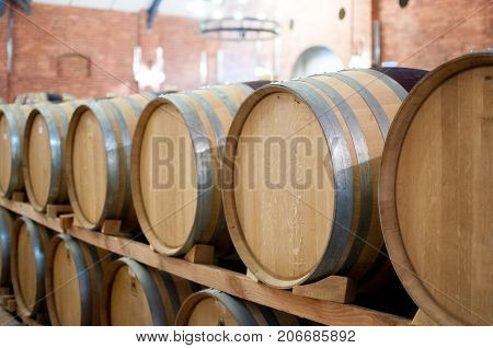 Casks barrels fermenting wine at winery brewery winemaking