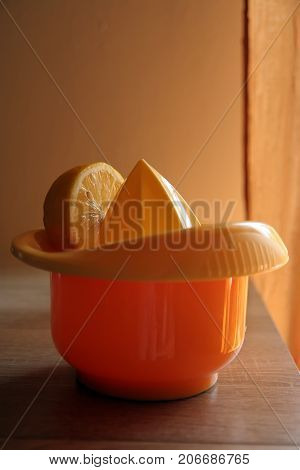 Lemon juicer. Manual lemon juicer. Lemon juice.