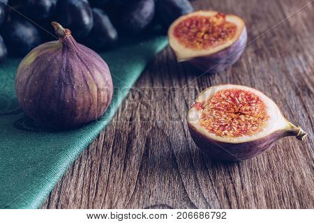 Figs on a wooden dark table. Still life with figs. Selective focus.