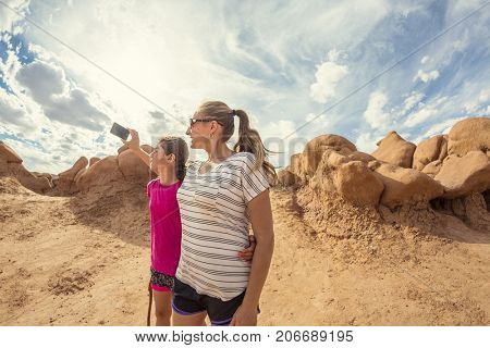 Family taking a selfie while hiking together in Arches National Park