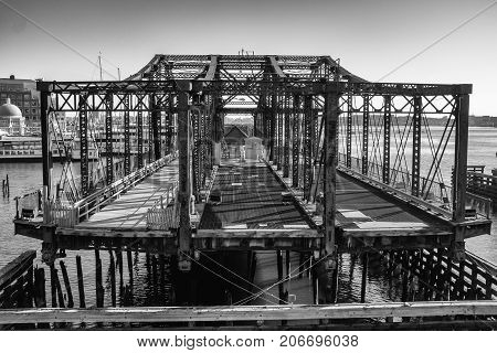 Closed footbridge in Boston's seaport district black and white