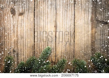 Christmas background - fir tree decorating rustic elements on vintage wood table with snowflake. Creative Flat layout and top view composition with border and copy space design.