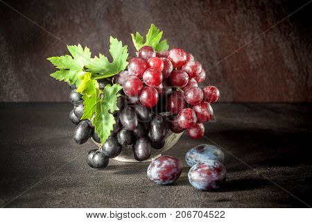 Still Life With Fruits: Grape, Plum In The Antique Copper Tin Cup