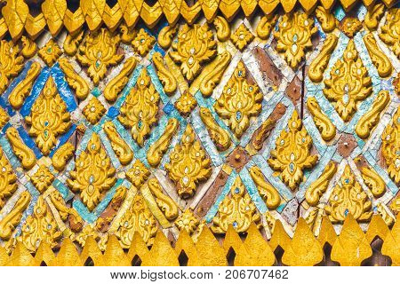 Bas-relief On The Wall Of The Temple Wat Sensoukaram In Louangphabang, Laos. Close-up.