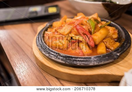 Rice cake or Dak galbi korean food is popular Korean dish made by stir frying marinated diced chicken in a gochujang based sauce with sweet potatoes, cabbage.