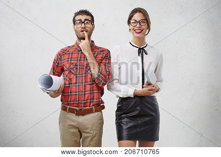 Worried Clunky Male Architect In Big Spectacles With Thick Lenses And His Pretty Female Wait For Bos