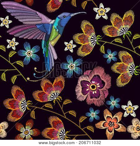 Humming bird and flowers embroidery seamless pattern. Template for clothes textiles t-shirt design. Beautiful hummingbirds and spring flowers embroidery on black background