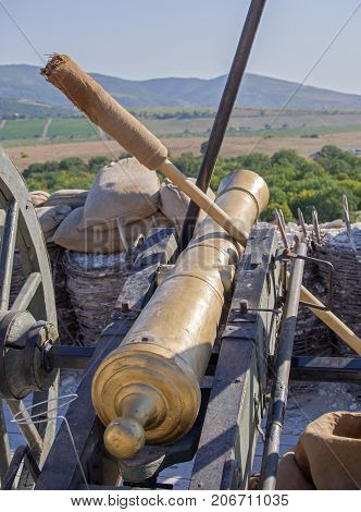 Old medieval artillery canon on the position