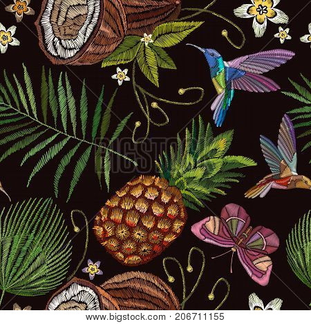 Embroidery humming bird palm tree leaves pineapple buterflly coconut tropical seamless pattern. Template for design of clothes. Fashionable embroidery tropical butterfly summer background