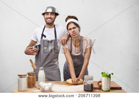 Displeased Female Cook Kneads Dough, Has Much Work, Being Tired After Long Preparation For Party, Re