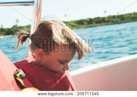 Caucasian Little Girl In Orange Life-jacket