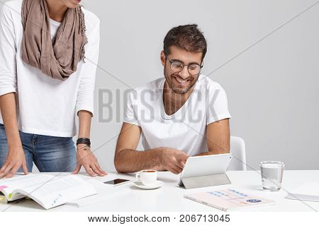 Happy Businessman And His Female Assistant At Office Near Table, Work With Documents, Drink Coffee,