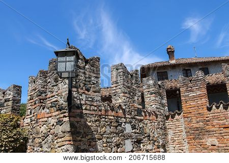 Fortification wall of ancient castle in Grazzano Visconti Italy