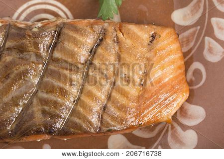 Salmon steak on a clay plate. Photo can be used as a whole background.