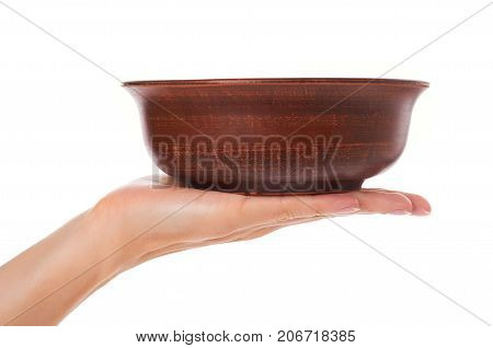 Clay Empty Brown Bowl In Hand Isolated On White Background