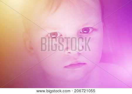 Boy offended face toned in pink and yellow background. Kids psychology threats help in medicine