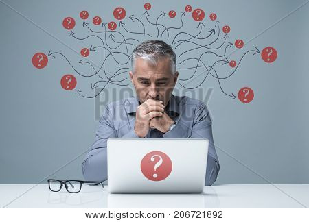 Pensive Businessman Working With A Laptop